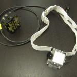 Das komplette System mit Stirnband und Batterien